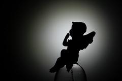 Thoughtful Angel (Agne Barde) Tags: silhouette macromondays macro closeup angel christmasornament decoration thoughtful blackandwhite bw monochrome