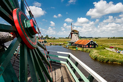 On top of the windmill (Maximilian Kauß) Tags: tags 2017 eos 650d raw stm windmill windmills windmühlen himmel sky wasser water efs18135mm dslr zaanse schans the netherlands niederlande holland typisch tipical sommer summer travel traveling urlaub kurzurlaub holiday reise landschaft landscape landleben natur nature clouds wolken amazing europa europe windkraft power plant museum zaanstad noordholland amsterdam bokehlicious windmühle above from top rad canon