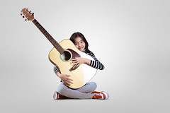 Little guitarist (Patrick Foto ;)) Tags: acoustic artist asian background beautiful beauty child chord classic classical concept cute female fun girl grey guitar guitarist happy instrument isolated kid learn leisure lifestyle little melody music musical musician one people person play portrait practice pretty sitting song sound string teen thai ukulele unplugged white young youth