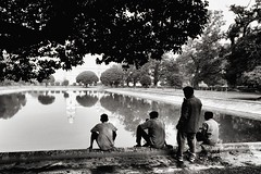 Kolkata (paola ambrosecchia) Tags: kolkata calcutta bnw monochrome beautiful amazing men water reflection sky trees nature landscape biancoenero mood india asia bw