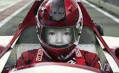 Baby pilot (François Tomasi) Tags: pilote pilot bébé baby garçon enfant child car auto f1 sport françoistomasi yahoo google flickr pointdevue pointofview pov photo photography photographie photoshop lights light lumière couleurs couleur colors color red rouge casque reflection france europe circuit automobile motor mécanique clovis neveu juin 2017 composition filtre
