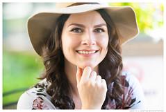 Heather - The Eyes Have It (jfinite) Tags: model beauty fashion environmentalportraiture summer hat curls brunette greeneyes