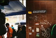 Bloody Gums - Bangkok (35mm) (jcbkk1956) Tags: om zuiko bangkok nana sukhumvitroad street thailand olympus 35mm analog kodak kodakgold200 50mmf14 manualfocus thai man gums stickers graffiti worldtrekker