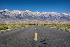 It feels good to be lost in the right direction. (Maripalli) Tags: lonepine easternsierras hwy395 landscape roadtrip nature road transportation blue sky snowcap snow desert desertscape