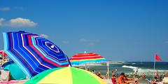 Sandy Hook Sunbathing (lauren3838 photography) Tags: laurensphotography lauren3838photography seascape umbrellas sunbathing summer beach sand atlanticocean ocean surf panoramic jerseyshore newjersey nj nikon d700 fx catchycolorsblue colorful sandyhook nationalpark postcard