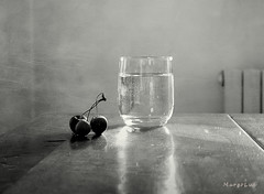 Summer Days ... (MargoLuc) Tags: glass water cherries heat summer time june soft window lighting table rustic wooden backlight minimalism stilllife bw indoor reflections