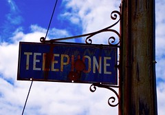 Telephone (rustyruth1959) Tags: nikon nikond3200 tamron16300mm uk scotland sutherland skerray sign telephone rust weathered metal pole outdoor sky blue wire brackets letters text clouds