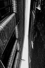 Never Underestimate The Protectiveness Of Narrow-Mindedness (Alfred Grupstra) Tags: architecture urbanscene blackandwhite builtstructure nopeople buildingexterior city window transportation modern citylife outdoors steel reflection blackcolor metal street abstract backgrounds pattern dordrecht
