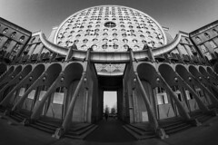 Cyclopus (Michel Couprie) Tags: architecture france europe seinesaintdenis bw blackandwhite noiretblanc nb urban composition city fisheye wideangle noisylegrand symmetry ville canon eos 7d samyang 8mm arch angle art arches couprie street people perspective