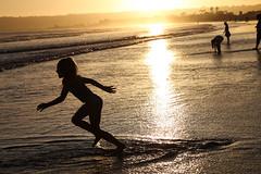 Season of Sun (KC Mike Day) Tags: sunset ocean pacific girl beach coronado california water shimmering golden light dream joy