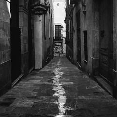 """Barri Gothic"" (giannipaoloziliani) Tags: dark darkness flickr streetcapture capture iphonephoto iphone old oldstreet streetphoto streetphotography water downtown city gothic barrigotic spain spagna barcelona barcellona monocromatico monochrome blackandwhite biancoenero"