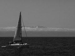 Shrouded Olympics (jcurtis4082) Tags: 40150mm bw blackandwhite clouds em1 olympicrange olympics olympus sailboat sanjuan snow wa