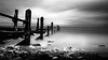 Maryport old pier (joeanthonyhill) Tags: beach sea shore pier waves water longexposure blackandwhite monochrome wood broken old coast cumbria grey dark sky overcast cloud rocks jetty weldingglass budget
