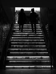 Walking to the light... (Michael Kalognomos) Tags: canoneos5dmarkiii ef24105mmf4l blackwhite bw streetlife stairs streetphotography athens greece lights women girls stickers people stairway staircase silhouette