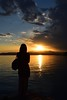 Siloulette (Tommy Terziotti) Tags: silhoulette girl estate summer ombra d5300 nikon mirrored italy italia sole sun reflection riflesso banchina lago borsa bag donna woman mountain orizzonte horrizon sunset tramonto nuvole clouds water black siloulette sirmione garda lake sky