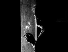 FUMANDO EN LA VENTANA (ala_j22) Tags: contraluz reflexion backlighting thoughts pensamientos decisions cigarette smoker smok humo