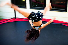 I got on a trampoline (backbeatb00gie) Tags: action backyard blur cartwheels child daredevil flip gymnastics motion neighbor nikon nofear trampoline