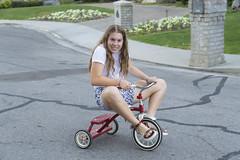 Teenage Tricycle (aaronrhawkins) Tags: jessica teenager girl trike tricycle ride walk stroll casual funny neighborhood provo utah family daughter pedal summer toosmall miniature wheel aaronhawkins