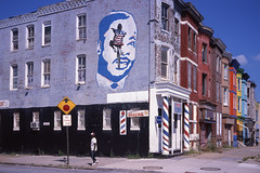 (patrickjoust) Tags: 6x9 medium format 120 90mm f35 fujinon lens film manual focus analog mechanical patrick joust patrickjoust baltimore maryland md usa us united states north america estados unidos urban street city people person chrome slide e6 color reversal expired mlk martin luther king jr mural kid bicycle bike corner barber shop avenue colorful standing