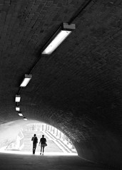 Follow the light (saxild) Tags: nikon fm2n nikkor 50mm 50mm18 ais kodak tmax tmax400 400 plustek 7400 scanner negativ film analog light people tunnel berlin germany