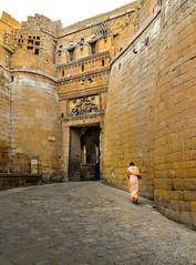 "A lady in saree walks through the ""Golden fort""! (@the.photoguy (insta)) Tags: saree lady orange jaisalmer rajasthan india explore ethnic dress woman sonarkella golden fort ancient history yellow goldenhour"