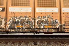 USUCK (TheGraffitiHunters) Tags: graffiti graff spray paint street art colorful freight train tracks benching benched racks autoracks usuck