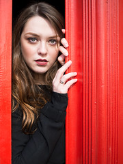 Red Door (mayflys_reach) Tags: unexpectedtales imogen imogenx availablelight abstract beauty brunette closeup england eyes fashion girl glamour innocence london naturallight olympus portrait people red telephonebox woman