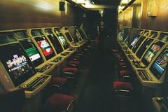 Arcade Gravity (benriley80) Tags: videoarcade arcade videogames coinop japan osaka tenma cigarette ashtray nikonf3 velour sitdown film fujic200 fujifilm