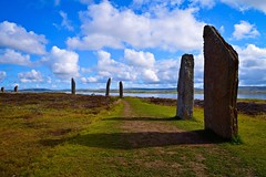 The Ring of Brodgar (rustyruth1959) Tags: nikon nikond3200 tamron16300mm scotland orkney ringofbrodgar stonecircle standingstones nessofbrodgar brodgar lochofharray lochofstenness neolithic outdoor stones path worldheritagesite grass shadows sky clouds water landscape