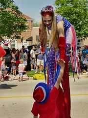 Touching Moment (Ken Mattison) Tags: parade people colour colors red redwhiteandblue outdoor 4thofjuly touching smile happy highfive interaction panasonic panasoniclumix fz1000 children boy hats stilts stiltwalker milwaukee greendalewisconsin wisconsin usa emotion happyface kids july