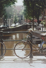 Amsterdam | another reverie (another reverie) Tags: amsterdam city netherlands citylife grachten gevels zenite analog agfa canals streets bicycle 35mm holland