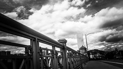 Bridge City (TMimages PDX) Tags: iphoneography photography image photo photograph streetscene fineartphotography geotagged people urban city street streetphotography portland pacificnorthwest sidewalk buildings avenue road blackandwhite monochrome vignette bridge skyline cityscape