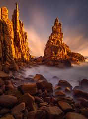 Hidden Cove Pinnacles (Bjorn Baklien) Tags: longexposure sunset clouds australia victoria phillipisland pinnacles cliffs rock waves ocean dusk glow prehistoric beautiful pentax645z light landscape seascape beach cove