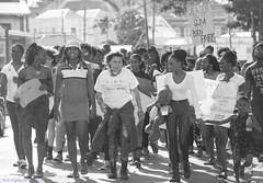 From All Walks Of Life (Nicky Highlander Photography) Tags: bridgetown barbados city capitalcity capital caribbean westindies lifestyle documentary lifeinleggings daily streetphotography black white blackandwhite monochrome photoessay backlit women solidarity march against gender based violence misogyny sign social justice causes people outdoor girl
