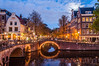 Canal Bridge Lights (Kenneth J. Garcia) Tags: amsterdam bikes bridge bridges canal canalbridges dusk europe jordaan jordaandistrict keizergracht leliegracht lights moon moonlight reflections thenetherlands water noordholland netherlands nl grachtengordel