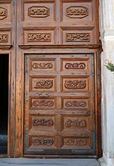 Carved wooden door (Badly Drawn Dad) Tags: cefalù geo:lat=3803986898 geo:lon=1402309027 geotagged ita italy sicily byzantine cathedral chiesa duomodicefalù foundedin1131 norman