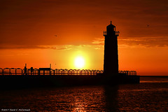 The Red Lighthouse (David C. McCormack) Tags: eos environment greatlakes harbor inspiration lakemichigan lakefront lake landscape lighthouse midwest milwaukeeriver outdoor pier sunriseset sunrise sunset wisconsin water milwaukee