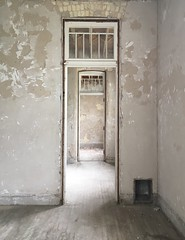 Silent Doorways (arrjryqp6) Tags: statehospital history abandoned silence past emptyrooms white texture asylum doorways