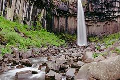 Svartifoss Waterfall in Skaftafell National Park (micheledibitetto) Tags: svartifoss iceland waterfall lava pillar organ pipe musk rock water skaftafell national park green nature river landscape paisaje