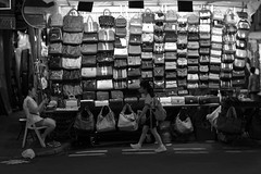 School girl and the Bag Sales, Jordan, Hong Kong (Job Homeless) Tags: schoolkid monochorme monotone m8 leica life living canon50mmf095 people portrait blackandwhite bw streetsnap streetphotography