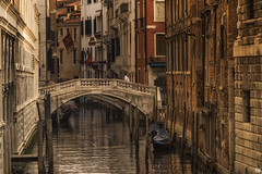 City of bridges (BAN - photography) Tags: bridges ponts architecture flags canal gondola boat water reflections shutters windows oldbuildings brick stone pylons tiles