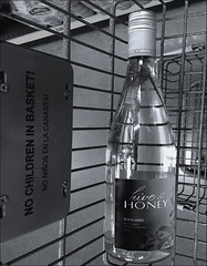 (Cliff Michaels) Tags: iphone photoshop pse9 bw black white wine shoppingcart kroger
