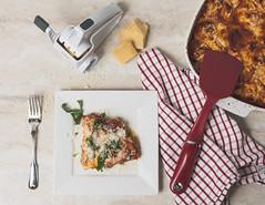 Top Down Zucchini Lasagna (lclower19) Tags: lasagna food cheese grater fork casserole spatula red white yellow towel basil tomato zucchini sb600