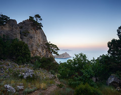 Sunset in the Crimea (czdistagon.com) Tags: scene landscape sea cliff rock mountain view nature tree pine sky coniferous stone hill crimea cloud top wood slope summer panorama cape blue horizon bay morning coast idyllic sunset panoramic rocky water background green needles branch cleft edge precipice russia height crevice south majestic ngc
