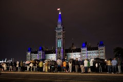 Northern Lights in the rain (beyondhue) Tags: canadian parliament lights sound northern beyondhue ottawa night dark summer people visitors umbrella rain wet long exposure gatineau canada peace tower