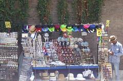 Trinket seller, Colosseum (morebyless) Tags: colosseum hats italy rome seller trinket