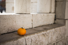 Mandarin on a stone wall (Ivanov Andrey) Tags: minimalism simplicity abstraction geometry focus idea element architecture creative space outdoor color concept emotion straightline symmetry stone block brick wall building history archaeology ancient angle vertical horizontal panel structure perspective picture background mandarin fruit orange shadow church christianity bethlehem israel