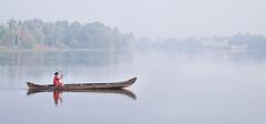 Backwaters, Cochin (Wanda Amos@Old Bar) Tags: india cochin backwaters water river boat rowing person red woman fog mist reflection