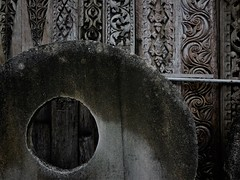 shapes and textures from the past (SM Tham) Tags: asia southeastasia indonesia bali island kuta circles circular millstone woodcarving panels antiques monochrome