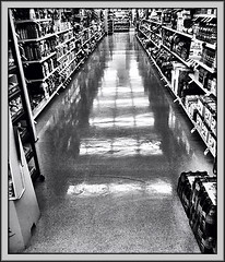 Aisle Eight (Bob R.L. Evans) Tags: blackandwhite grocerystore waxedfloor food commercial converginglines linoleumfloor